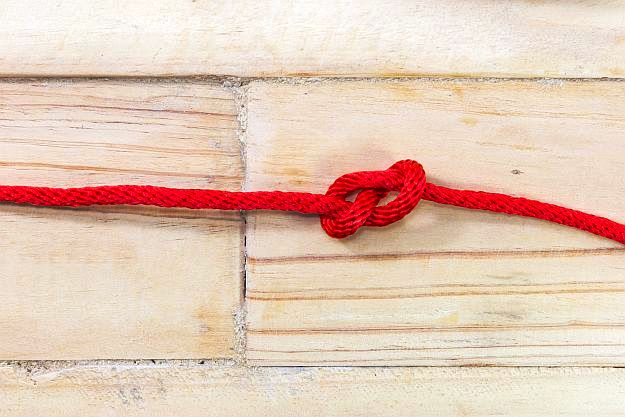 Step 2: Tie A Knot   How to Make A Popcorn Garland For Fun Free Holiday Decor