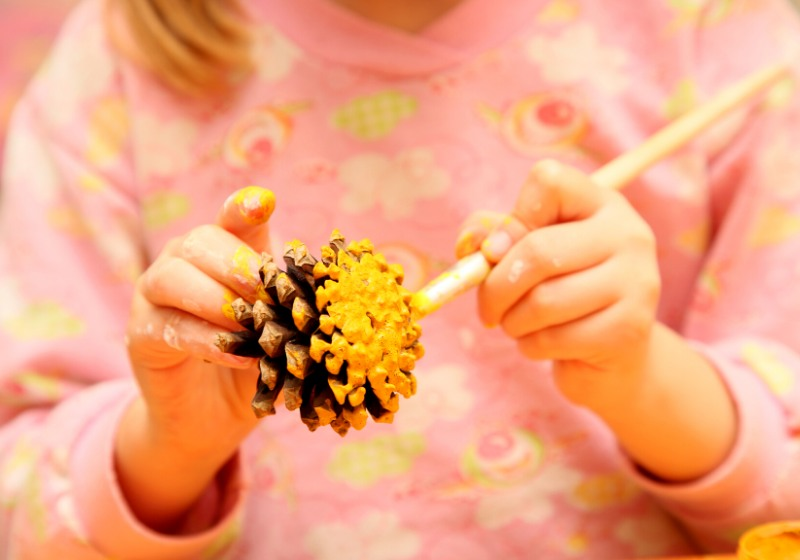 child painting pinecone yellow colour | paper easter crafts