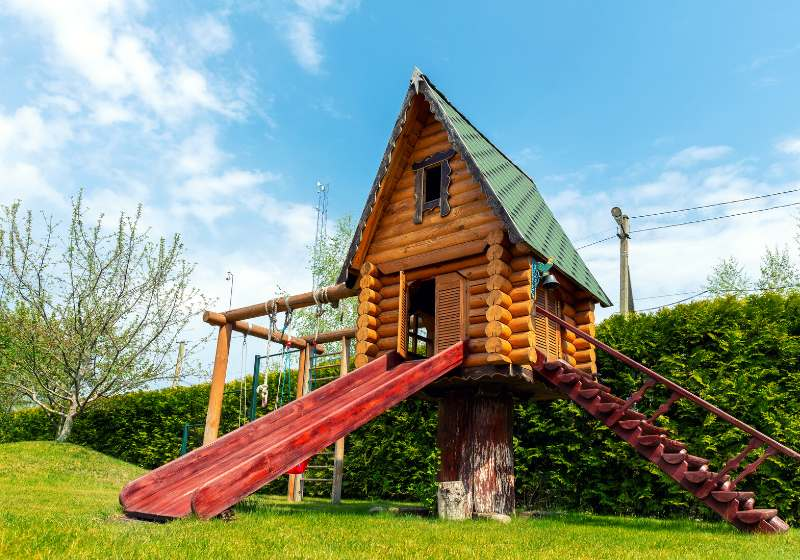small wood log playhouse hut stairs | cool treehouse ideas